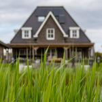 brown house behind green grass